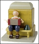 "Savings Oven (Bank) Boy With Concertina 3 ¾"" tall, 3 ½"" wide, and 3 ½"" deep"