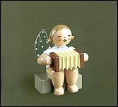 Angel With Concertina Sitting – 2.