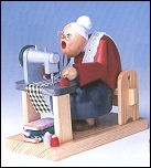 Dressmaker With Sewing Machine Smoker Sitting – 6.3″